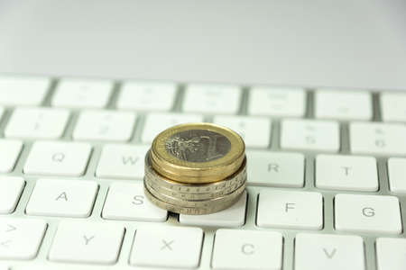 indebtedness: Euro coin and keyboard Stock Photo