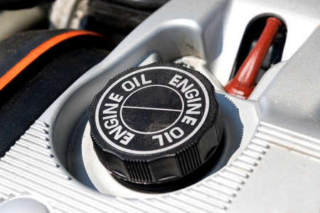 An engine of a car and oil lid Stock Photo