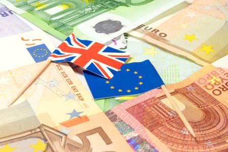 Euro money, European Union flag and Great Britain flag
