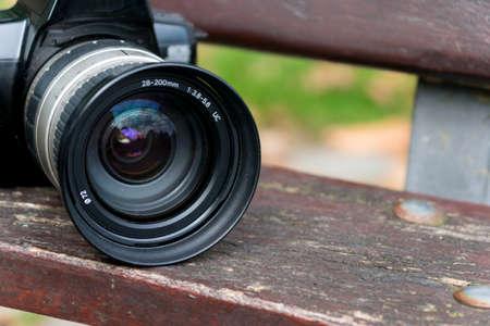 A photo camera on a park bench Stock Photo