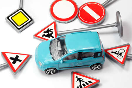 A car and various traffic signs