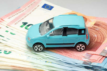 A car and many euro banknotes