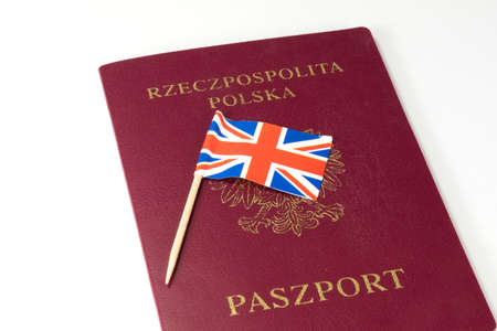 A Polish passport and the flag of Great Britain