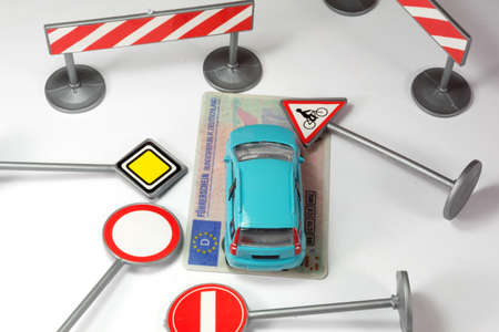 Drivers license and various traffic signs