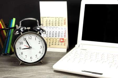 Notebook, calendar and alarm clock