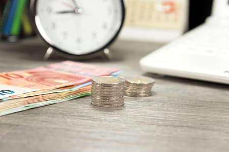 indebtedness: Euro money, watch and notebook Stock Photo