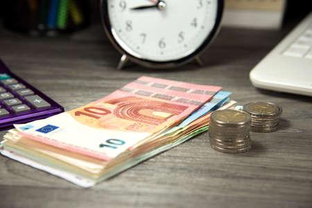saving tips: Euro money, watch and computer