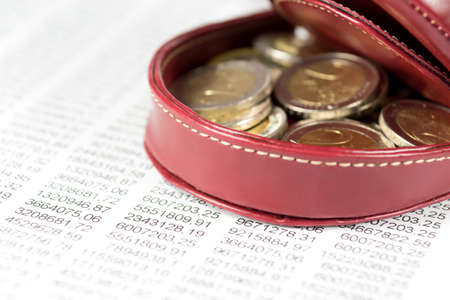 indebtedness: Euro coins in wallet and charts Stock Photo