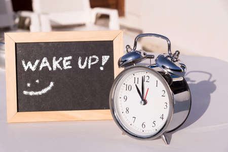 Alarm clock and wake up in the morning Stock Photo