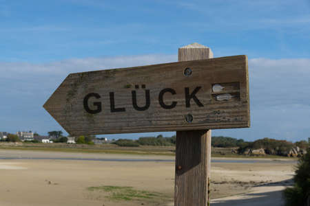 Wooden signpost to happiness