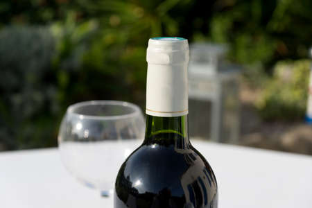 Bottle of wine and wineglass on the table