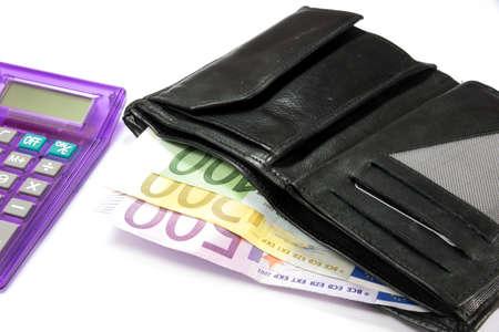 Euro money, calculator and wallet Stock Photo