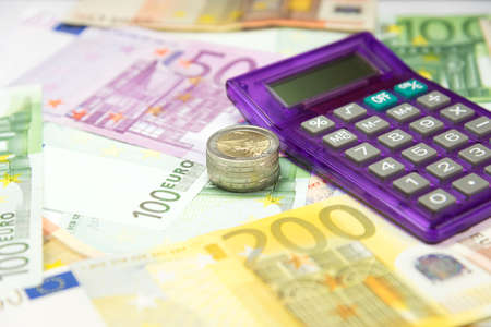 indebtedness: Euro money and calculator Stock Photo