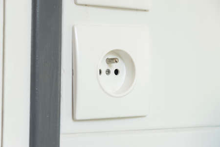 electricity tariff: Electrical socket on the wall Stock Photo