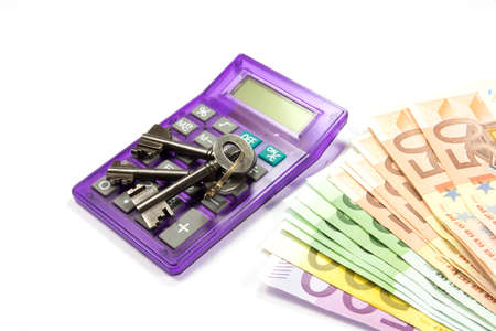 indebtedness: Euro money, keys and calculator Stock Photo