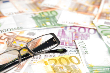 indebtedness: Euro money, glasses and charts Stock Photo