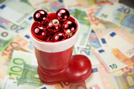 indebtedness: Euro money and Christmas decorations Stock Photo