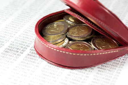 indebtedness: Calculating table, euro coin and purse