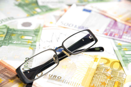 indebtedness: Euro money, charts and glasses