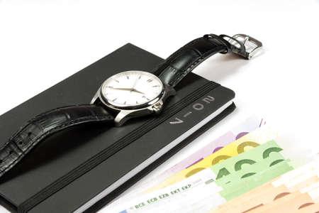 Euro cash, watch and calendar