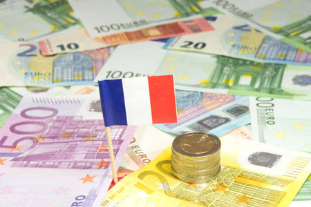 indebtedness: Euro money and French flag