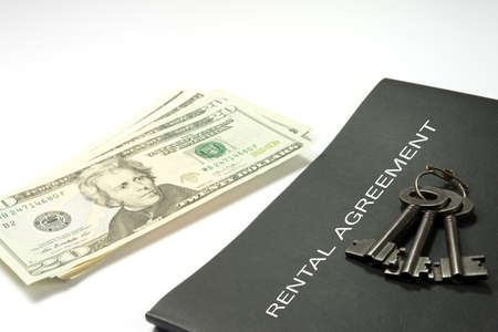 A rental agreement, money and keys for the apartment