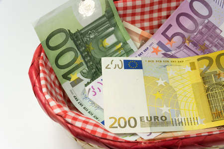 Many Euro banknotes in a basket
