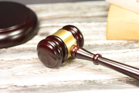 A gavel and different statutes Stock Photo