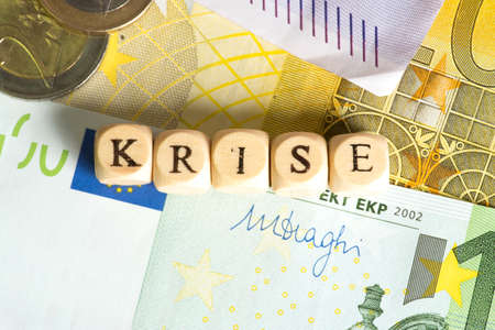 Euro money and the word crisis Stock Photo