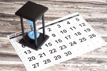 secondhand: An hourglass and a calendar