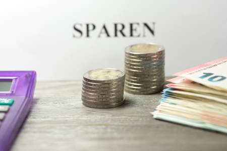 budgetary: Euro money, calculator and the German word saving