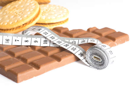 Chocolate, biscuits and a measuring tape Stock Photo