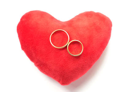 A heart and two golden wedding rings