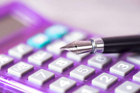 budgetary: A calculator and a fountain pen Stock Photo