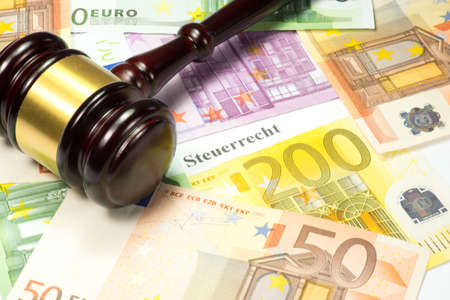 Gavel, euro bills and German tax law