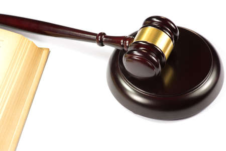 statutes: A gavel and a law book Stock Photo
