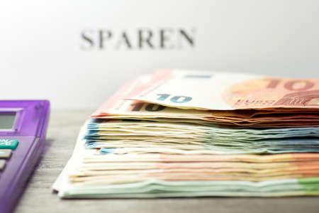 budgetary: Pocket calculator and money savings Stock Photo