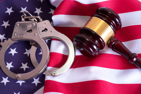 American flag, gavel and handcuffs