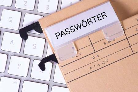passwords: A hanging folder with passwords and a computer