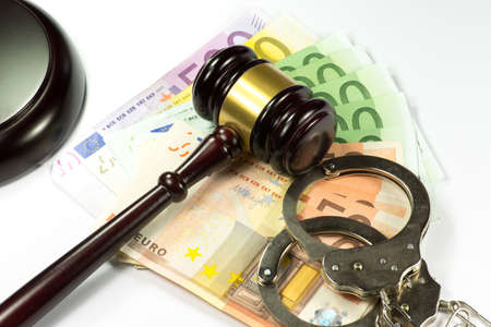 Euro money, handcuffs and gavel