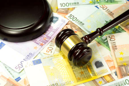 indebtedness: Euro money and hammer judge Stock Photo