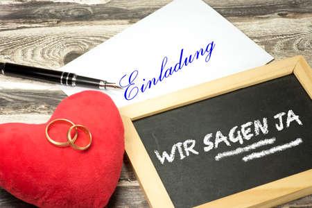 Wedding rings and a wedding invitation