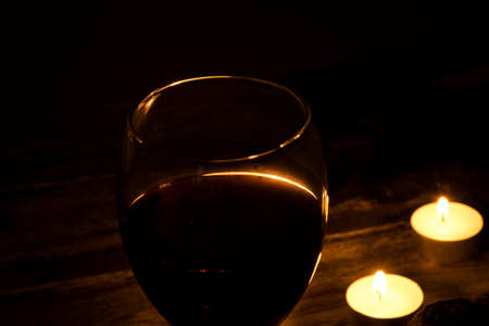 A glass of wine and candles Stock Photo