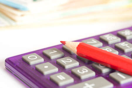 Euro money, calculator and red crayon Stock Photo