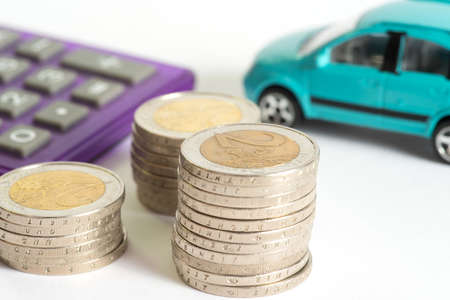 Euro coins, car and calculator