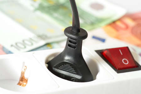 Euro money and power strip Stock Photo