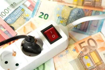 electricity tariff: Euro money and power strip Stock Photo