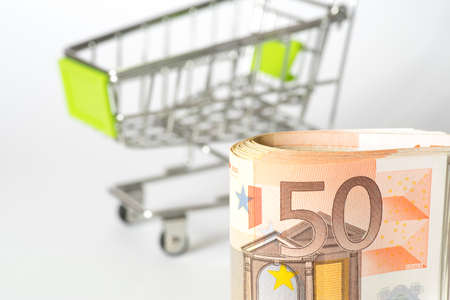Euro money and shopping cart Stock Photo