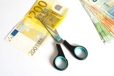 Euro banknotes and scissors