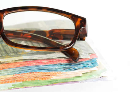 Euro banknotes and glasses Stock Photo